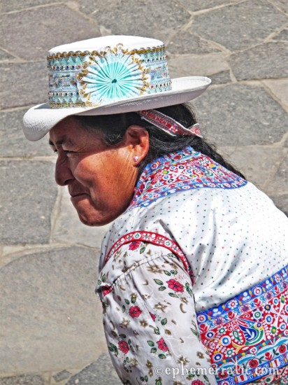 Peruvian tribal embroidered outfit, road to Colca Canyon, Peru photo