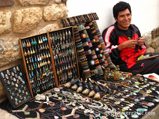 Making bespoke jewelry on the street, Cusco, Peru photo