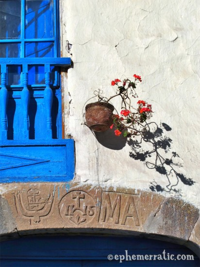 Blue window and red flowers, Cusco, Peru photo