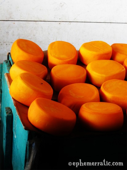 Orange wheels of cheese in Cusco's Central Market, Peru photo