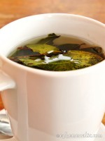 A mug of mate de coca or coca tea, Cusco, Peru photo