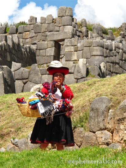 This tout wears many hats, Cusco, Peru photo