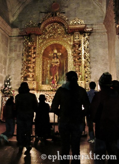 Altar faithful at La Compañía, Arequipa, Peru photo