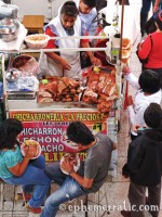 Eating chicharron, Mercado San Camilo, Arequipa, Peru photo