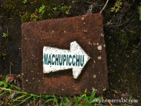 Sign with arrow pointing to Machu Picchu, Peru photo