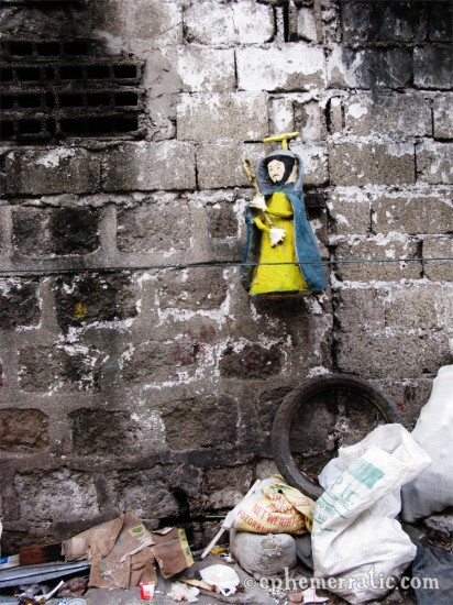 Yellow Jesus of the trash, Manila, The Philippines photo