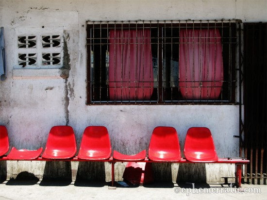 Red chairs at the docks, Manila, The Philippines photo