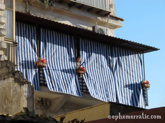 Blue striped curtains and neighbor, Palermo, Sicily, Italy photo