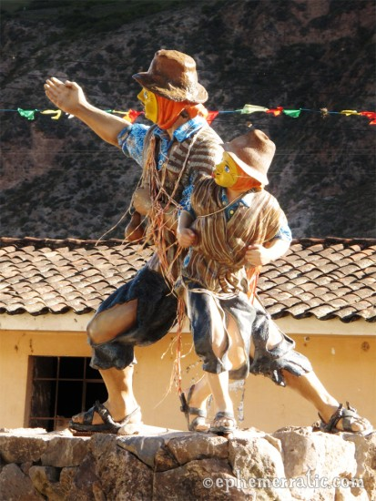 Yellow-masked statue of boy and man, Sacred Valley, Peru photo