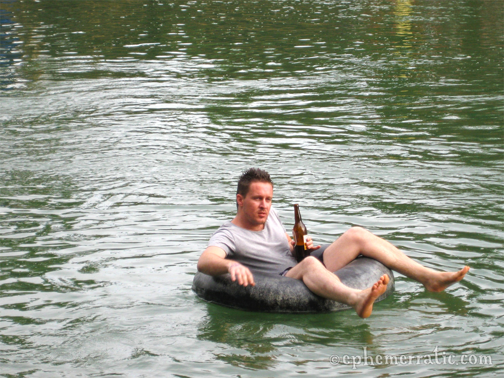 Tourist, Beer Lao, and a tube in Vang Vieng, Laos