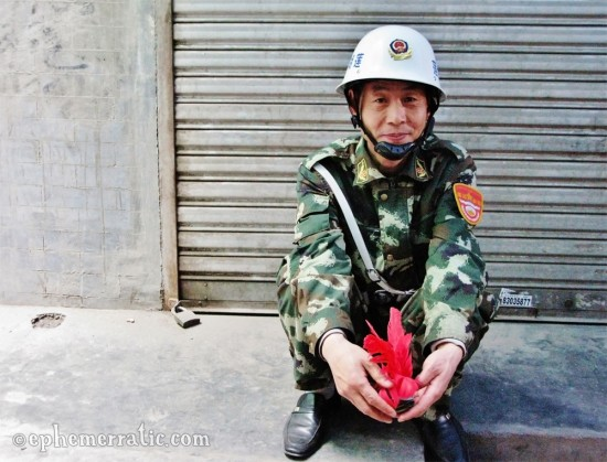 Military man with shuttlecock, Xi'an, China photo