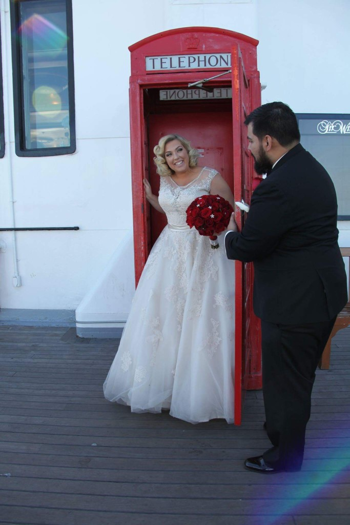 Plus sized wedding gown illusion neck ballgown with lace and crystal beading.