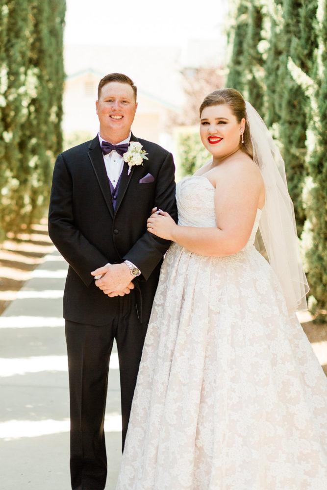 newlyweds outdoor wedding strapless lace plus size ballgown wedding dress