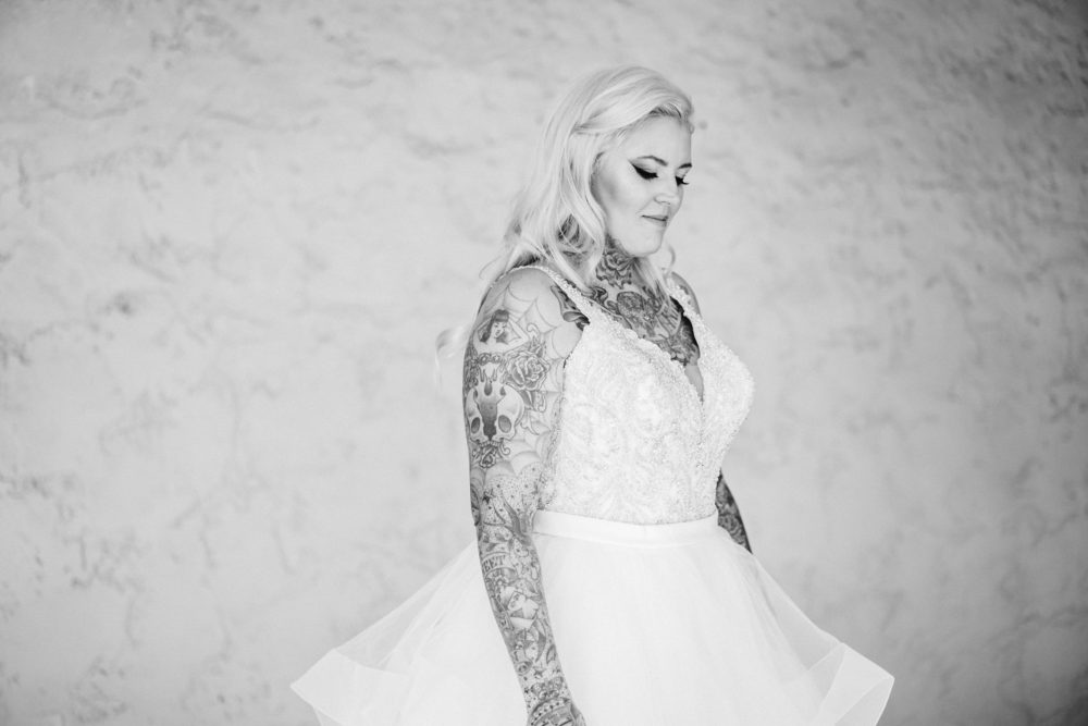 Plus size bride with tattoos