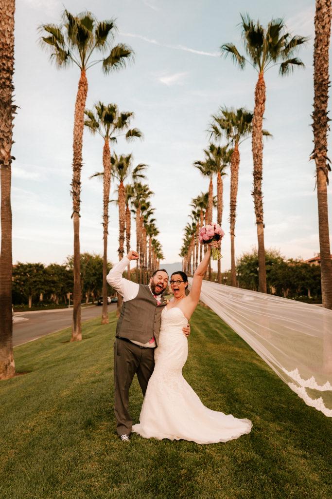 happy plus size bride wearing lace mermaid wedding dress