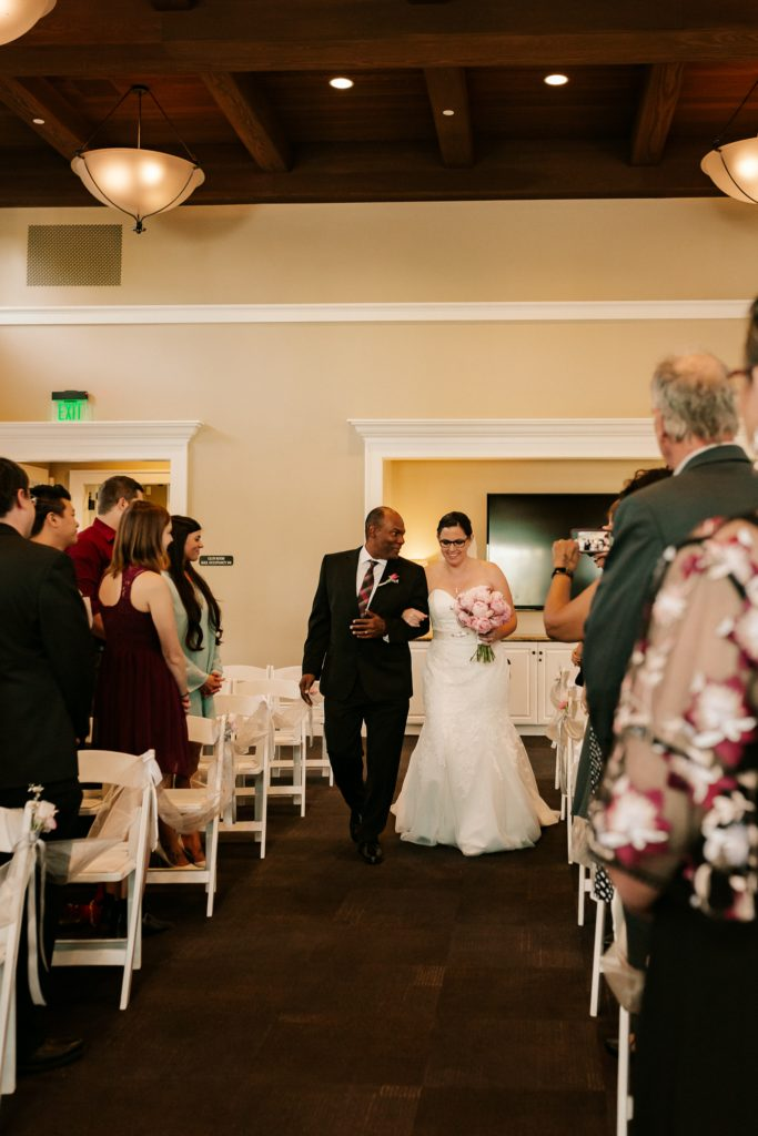 real plus size bride walking down the aisle