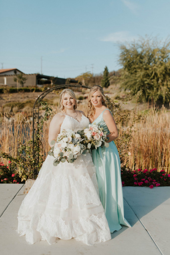 real plus size bride and bridesmaid in satin dress