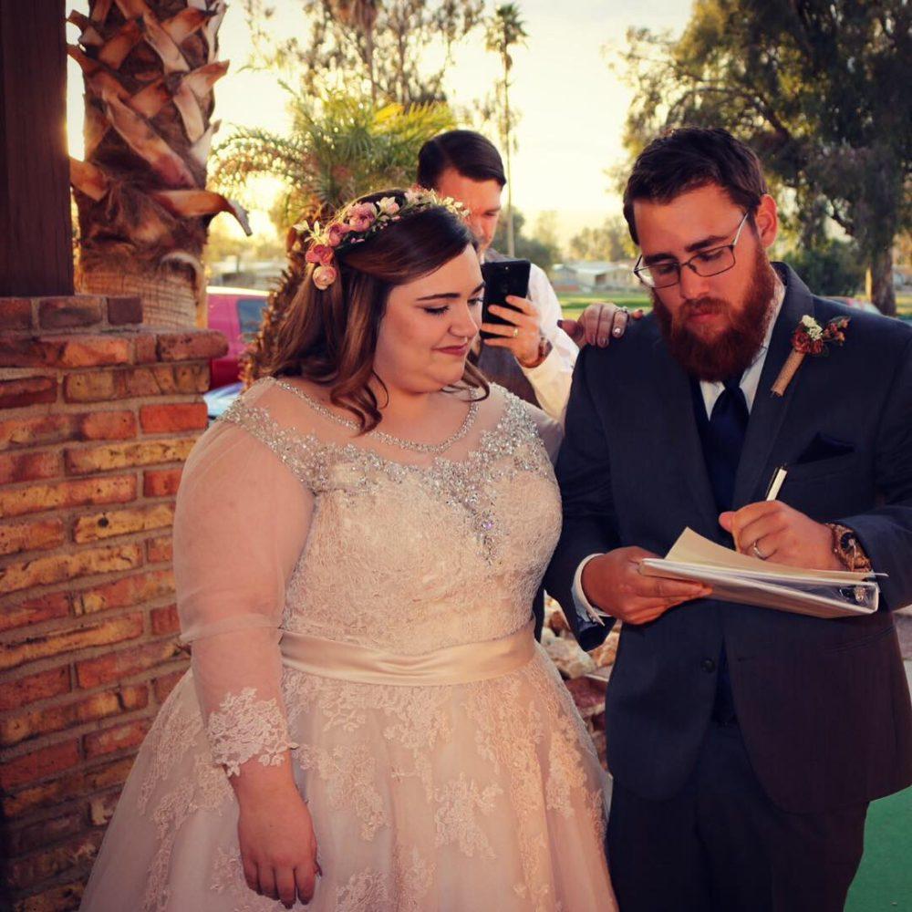 curvy bride in champagne ballgown wedding dress
