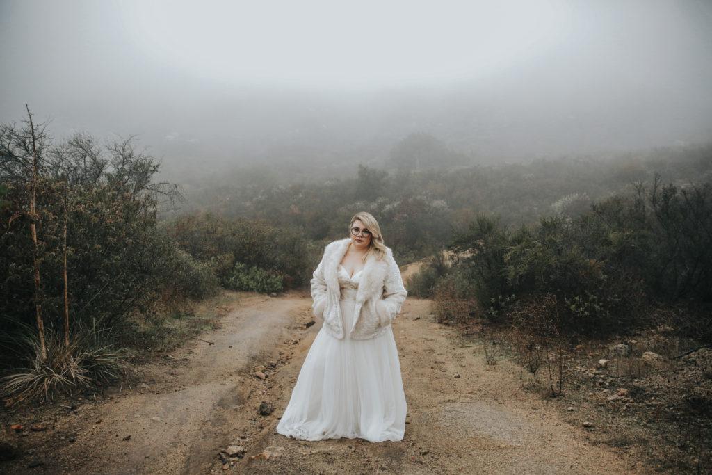sassy plus size bride in custom wedding dress with fur coat