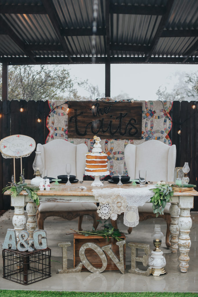 wedding day sweetheart table with cake