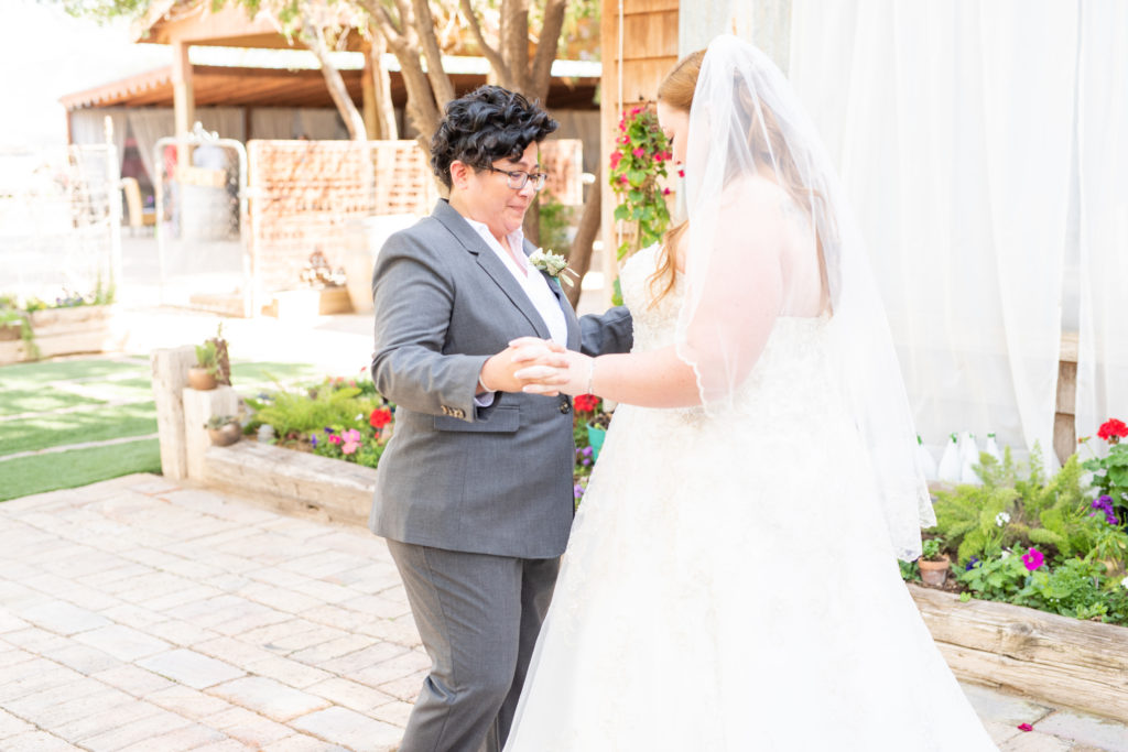 first look with couple in suit and wedding dress
