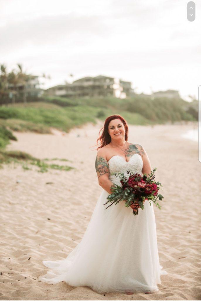 flowy wedding dress on beach