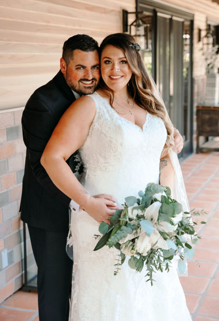 newlyweds Sean and Alexis, who is holding a bouquet