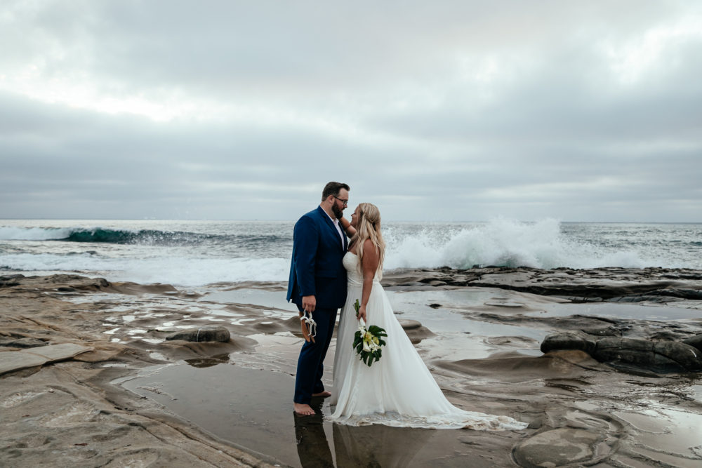couple-on-beach-wearing-chiffon-bottom-beach-wedding-dress-california