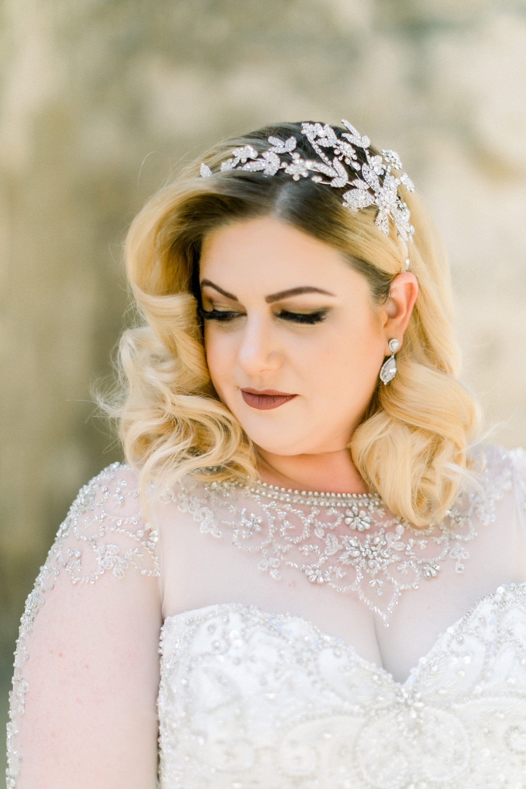 bride portrait with rhinestone headpiece and beaded long sleeves and neckline