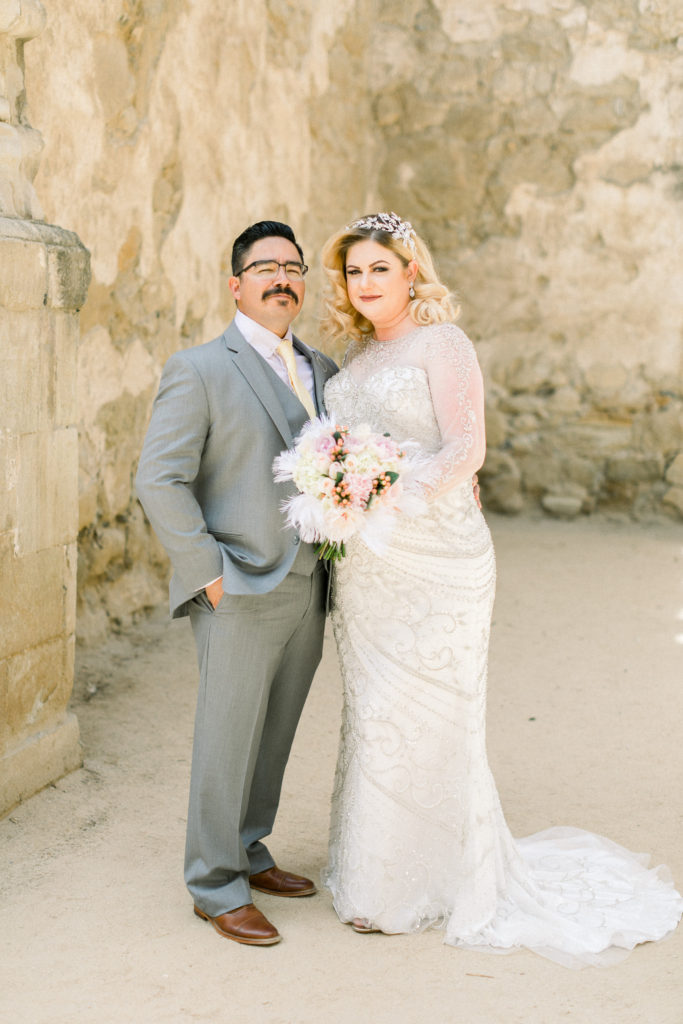 wedding couple poses at the mission san luis obsipo in california
