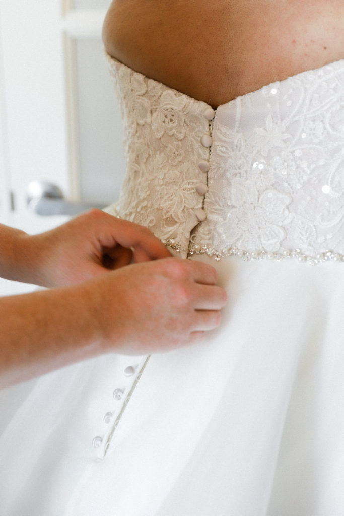 buttons-over-zipper-on-wedding-dress