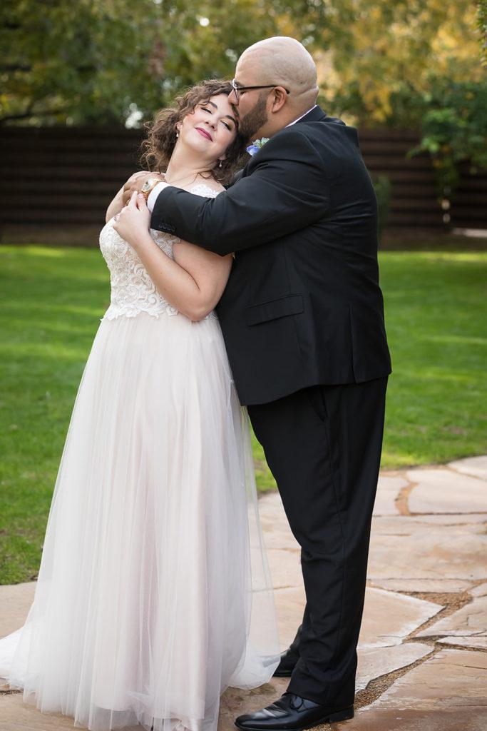 bride-wearing-tulle-aline-wedding-dress-and-groom-in-tux