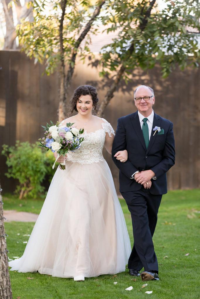 beautiful-bride-walking-down-the-aisle-outdoor-wedding-phoenix