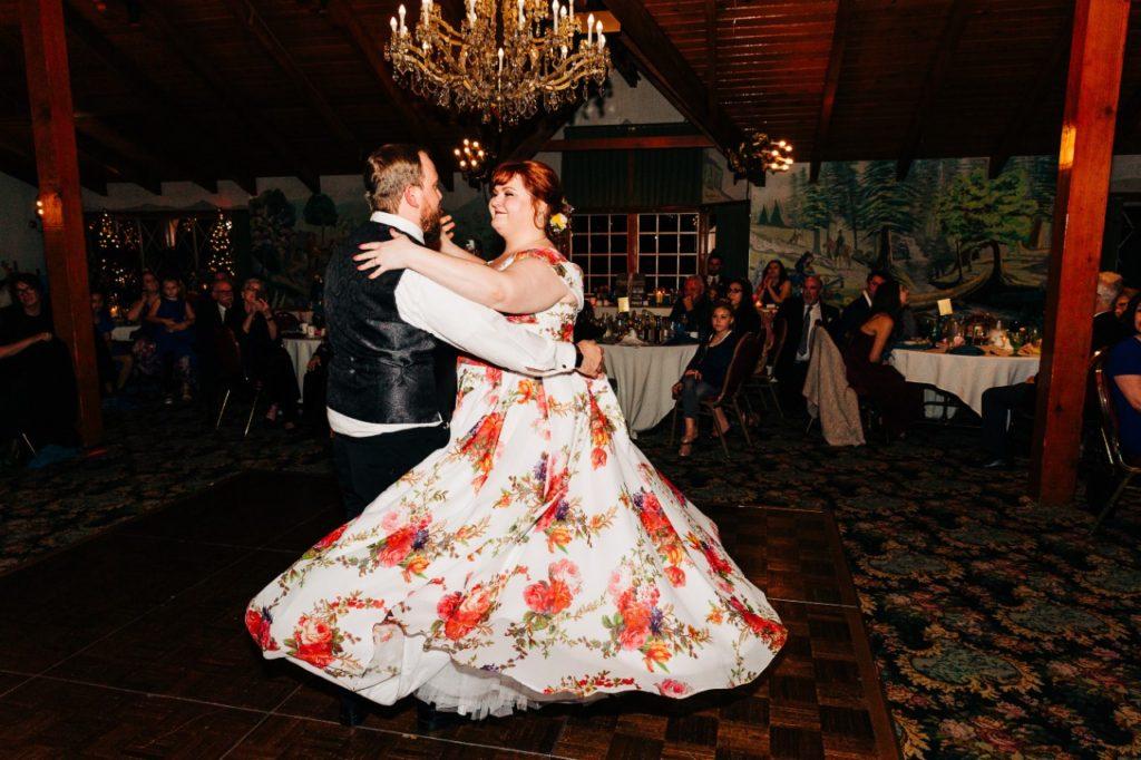 plus-size-bride-twirling-in-floral-chiffon-wedding-dress
