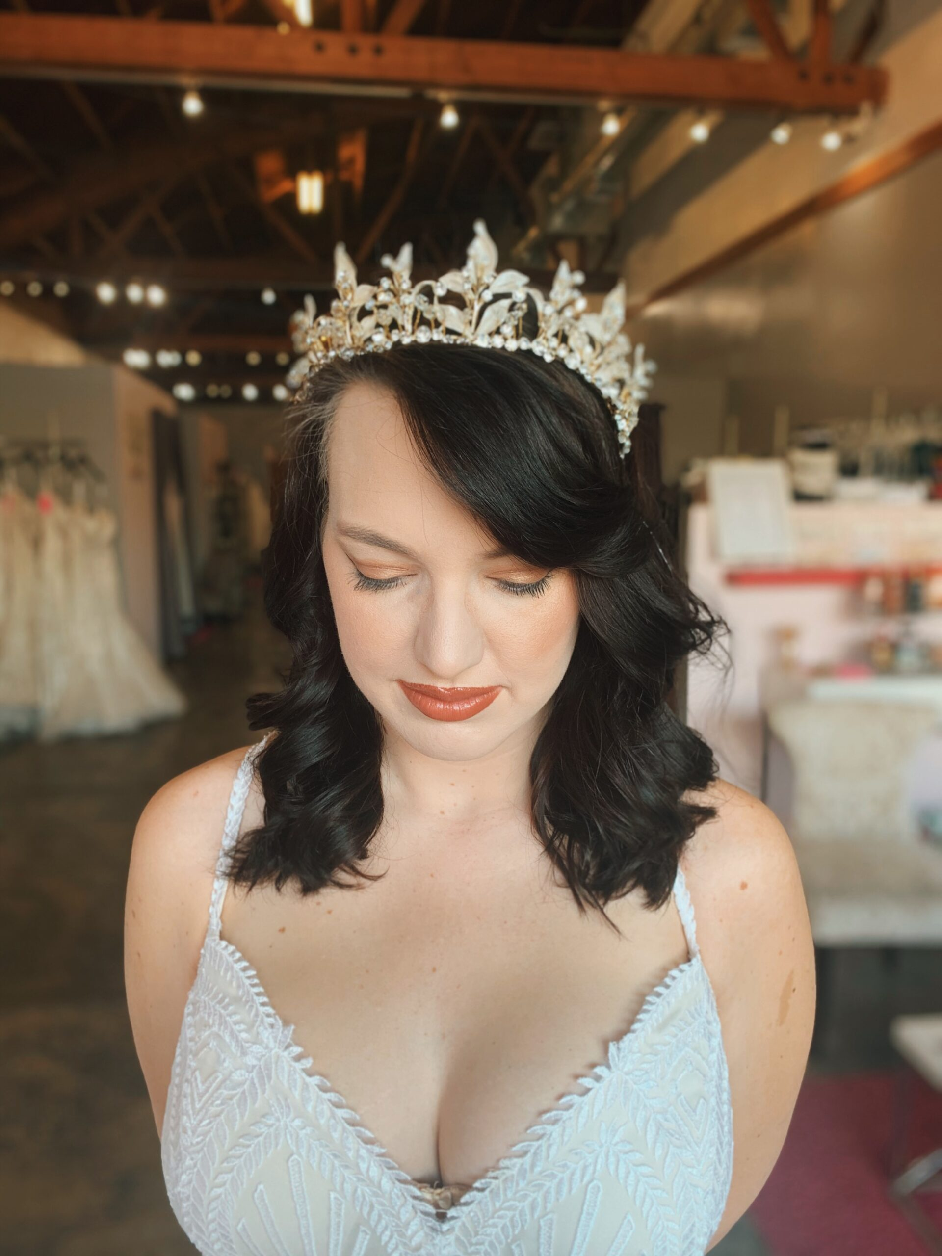 gold princess wedding down on bride with long brown hair