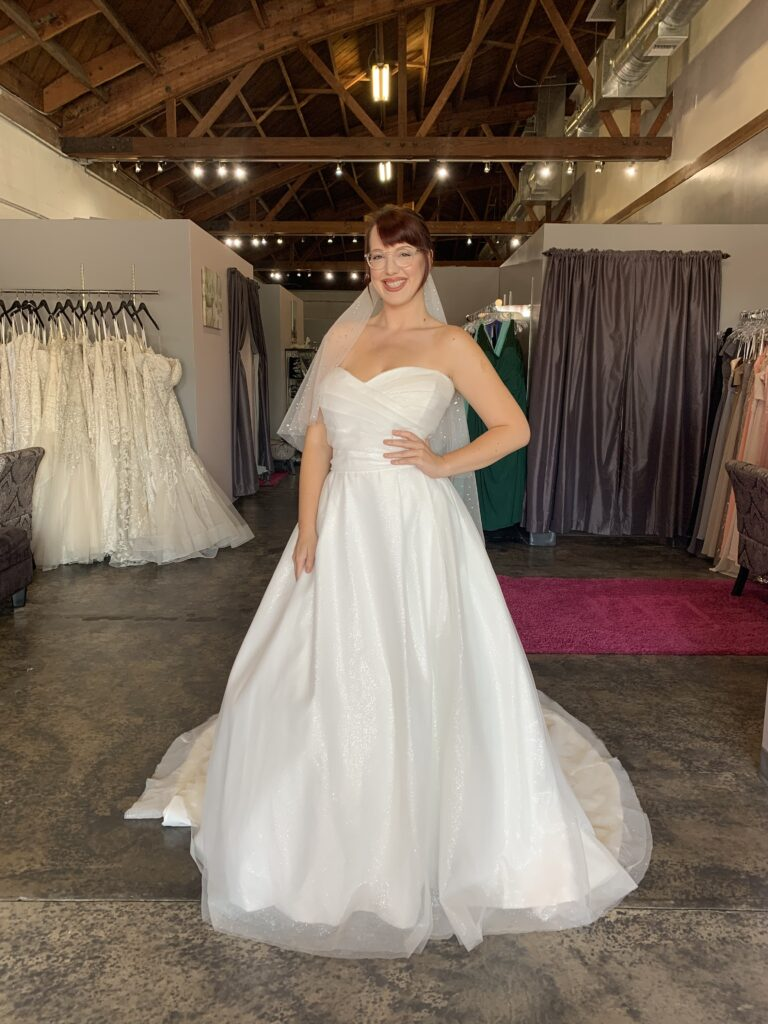 Sweetheart neckline sparkle tulle ball gown ruched bodice with sparkle stars and moons veil on tall model in long beach california
