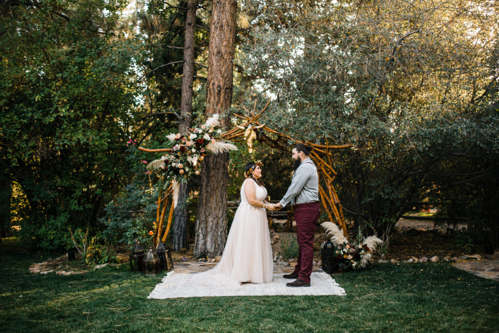Bride and groom bobho ceremony site in forest
