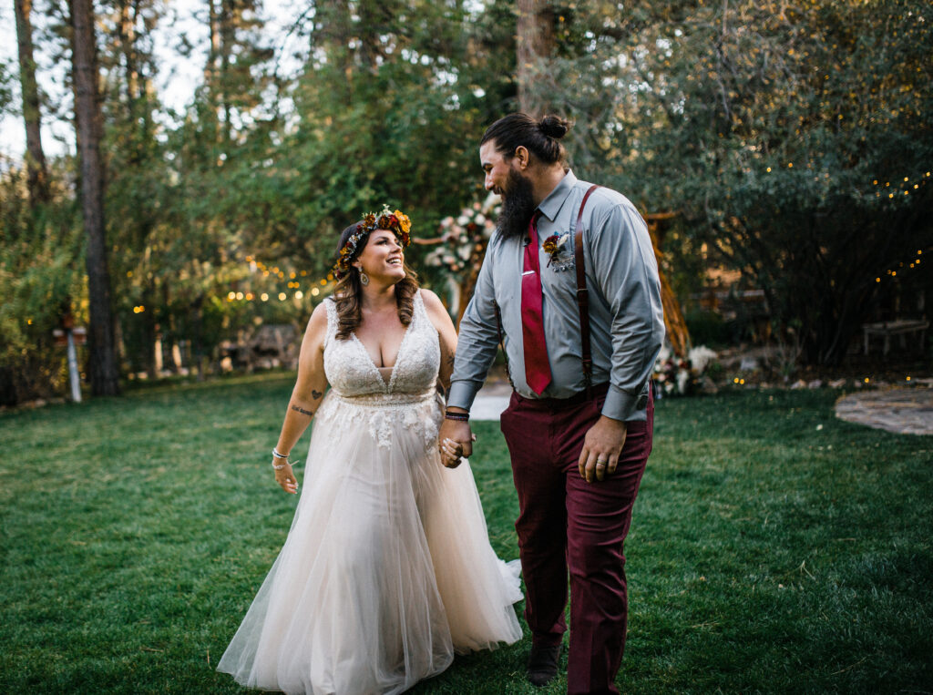 Smiling happy couple just married in nature boho elopement