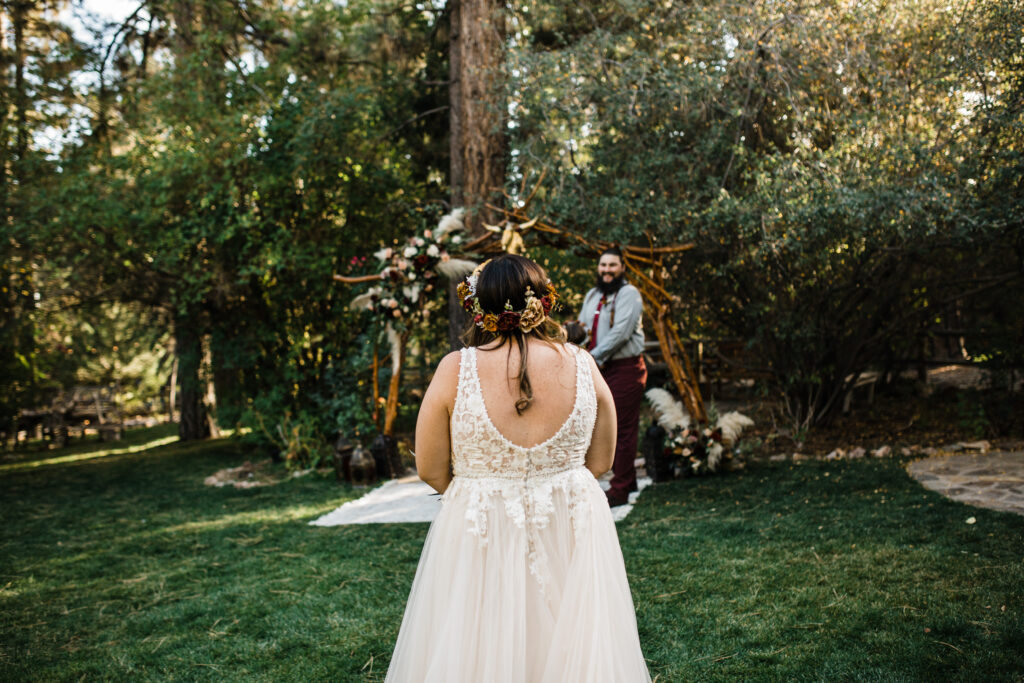 Back of bride with boho wedding dress v neck back