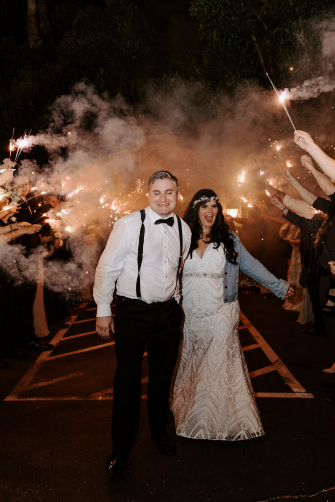 newlyweds with sparkler exit