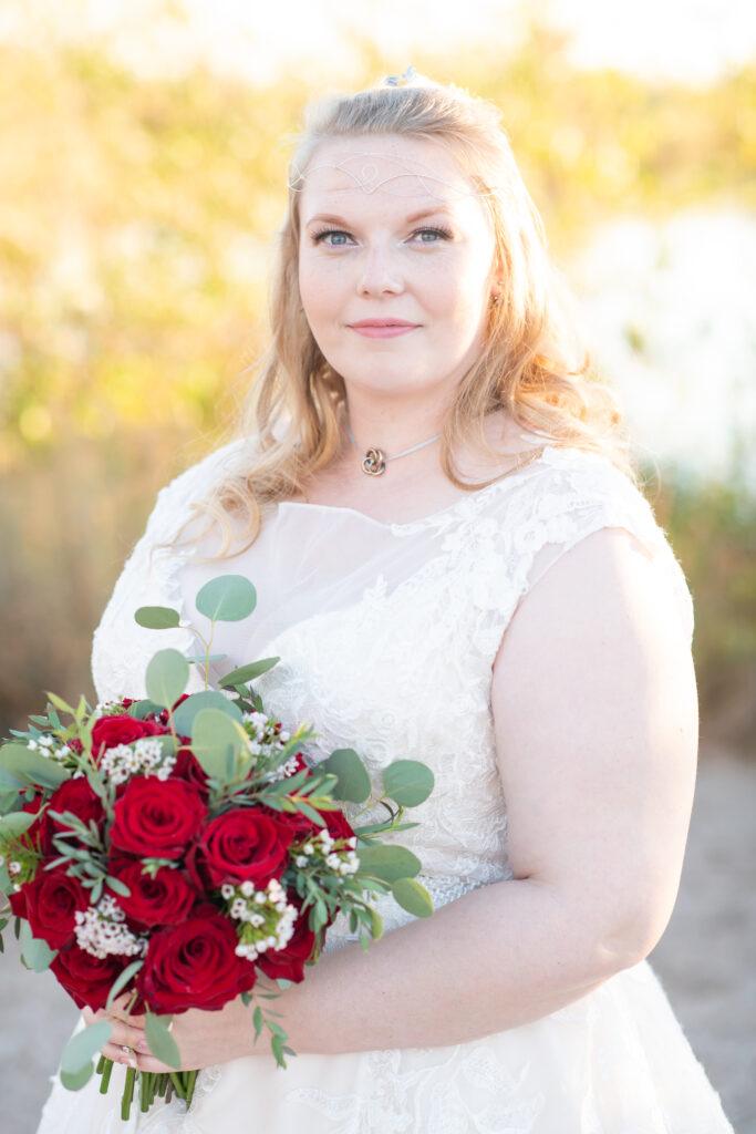 plus size bride with ballgown wedding dress holding red bouquet gilbert arizona