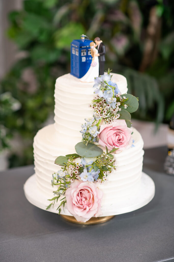 wedding cake with tartis and flowers