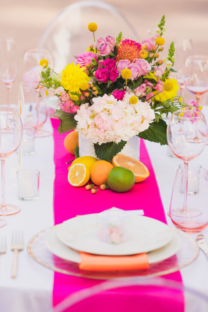 pink table runner with fresh cirtus fruit wedding table