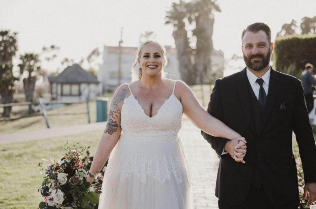 bride wearing a unique lace aline wedding dress and groom in a suit