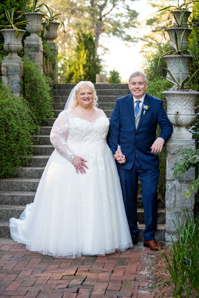 older couple long sleeve wedding dress and navy suit