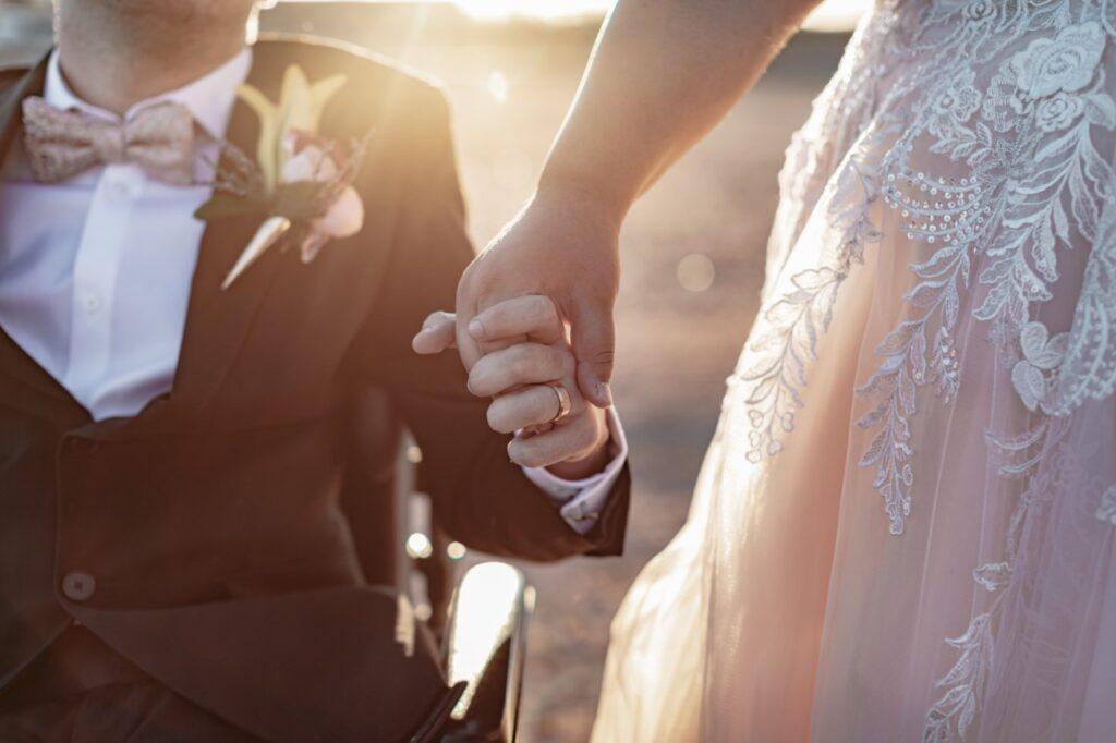 newleywed couple holding hands