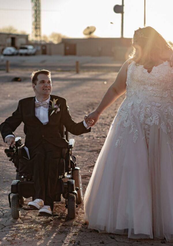bride and groom in wheelchair