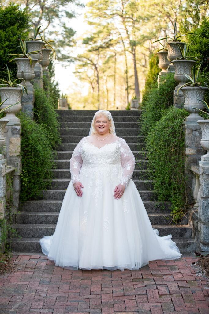 super plus size bride in custom long sleeve wedding dress