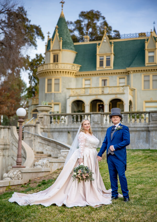 plus size bride and groom in suit outside wedding venue california
