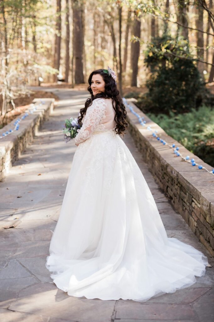 bridal seating long sleeve ballgown wedding dress in forest venue